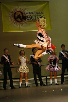 Parade of champs. Notice how the other dancers are looking UP at her - that's how high she is off the ground.