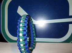 Vancouver Canucks NHL Survival Paracord Bracelet Survival Straps, Vancouver Canucks, Paracord Bracelets, Nhl, My Style, Hockey, Blue, Ebay, Gift