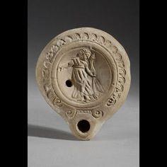 Roman Terracotta Lamp with an Ecstatic Maenad | 4th Century AD | Price $0.00 | Roman | Terracotta | Vessels | eTiquities by Phoenix Ancient Art