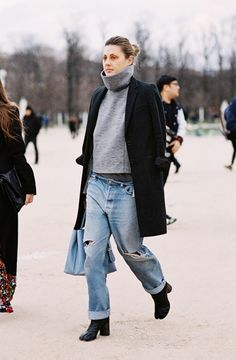 Keep warm with a thick turtleneck sweater, classic coat, and baggy jeans