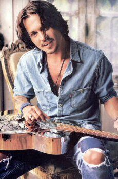 Johnny Depp can make any guitar look good