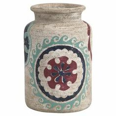 """Terracotta vase with a painted Navajo-inspired medallion motif.   Product: VaseConstruction Material: TerracottaColor: MultiDimensions: 10.75"""" H x 7.25"""" Diameter"""