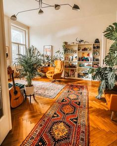 Best way to cozy up a big space: patterned rugs and lots of plants. Design goals by via Boho Living Room, Living Room Decor, Cozy Eclectic Living Room, Eclectic Decor, Cozy Living Rooms, Living Room Warm Colors, Living Room Plants, House Plants, Aesthetic Room Decor