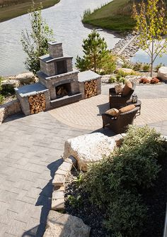 The Stone Oasis Fireplace with a lake view is always a great relaxing area. Stone Fireplace Designs, Precast Concrete, Outdoor Fireplaces, Outdoor Living, Outdoor Decor, Fire Pits, Lake View, Outdoor Entertaining, Oasis
