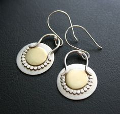 Gorgeous pairing of sterling silver and brass...