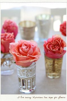 Simple but classy flower centerpieces - this would be good for a bridal shower - good way to add color in a simple, chic way. Could even have them in a straight line for longer tables at weddings, birthdays or other anniversaries...