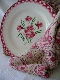 white and pink flower plate with matching towel