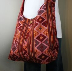 Reversible Crossbody bags - red byzantine. $30.00    Made by women in northern Thailand, our cross body bags were made with dignity.