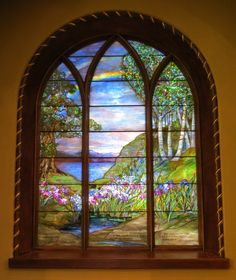 A stunning Tiffany rainbow window. Perhaps not unlike the one at the Gosfroth Academy. Is that Bifrost in the distance...?