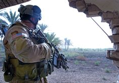 U.S. Navy SEAL operator takes cover from enemy fire while conducting a search and rescue mission for three missing soldiers near Baghdad, Iraq, May 13, 2007