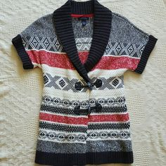 Tommy Hilfiger sweater Cozy red, cream and black sweater in great condition! Beautiful patterns and quality fabric. Great paired with leggings or skinny jeans for a cute outfit! Tommy Hilfiger Sweaters Shrugs & Ponchos