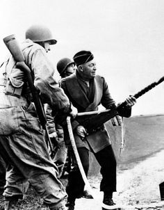 Eisenhower firing a Browning light machine gun from the hip.  He was our last great President.
