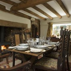 """""""A log-burning stove makes a stunning feature in the inglenook fireplace, while exposed beams bring rustic charm.  As featured in 25 Beautiful Homes."""" kitchen-appliances1"""