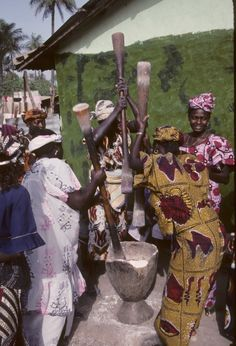 Pounding Millet is a group activity in the Gambia
