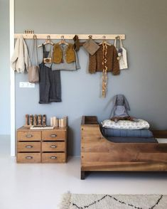 Loving the blue + wood combination. Simple yet effective http://petitandsmall.com/5-stunning-minimal-kids-rooms-warmth/