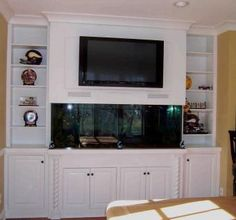 Built-In Fish Tank Entertainment Center.