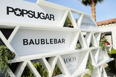 At PopSugar and ShopStyle's Cabana Club, which took over the Avalon hotel, an open step-and-repeat wall trailed with succulents and greenery. The geometric moif also allowed for organizers to swap out logos for the various events that took place in the space over the course of the weekend.  Photo: Mike Windle/Getty Images for Popsugar