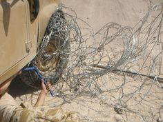 I can almost feel the pain of getting this wire mess off. Land Rover Series 3, Military Humor, Funny Pictures, Lol, Dark, Soldiers, Awesome, Fanny Pics, Funny Pics