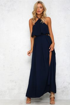 The In My Element Maxi Dress has a stunning cut away back and ruffle across the bust. With a tie up neck and back, there is a slight pleat through the voluminous maxi skirt. Make it pop with a silver envelope clutch and a minimal bangle! Dress. Partially lined. Cold hand wash only. Model is standard S and is wearing S. True to size. Non stretchy fabric. Polyester.