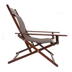 """Product Details:  Watch the sun go down or the world go by as you relax in this rosewood and canvas lounge chair recreated from an era of siestas and mint juleps. Extended flattened arms allow for hauling yourself up, perching your leg over the side or placing a drink. A solid brass mechanism enables you to have a choice of three reclining positions. Folds quickly and compactly for storage or transport. Dimensions  H:38 ½"""" W:26 ½"""" D:44 ½"""""""