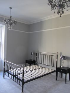 Guest Room - Farrow and Ball Pavilion Grey walls and double chandeliers. Lamps from Laura Ashley