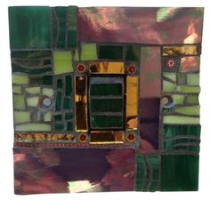 Light switch in green and mauve - This 'Landscape' mosaic hand crafted in Murano and Tiffany Stained Glass.Size 9 x 9 x 1.5 cm. This mosaic light switch comes with matching screws and with UK approved standard electrical fitting. Size 9 x 9 x 1.5 cm. Please feel free to send me a message on Pinterest for commissions.