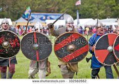 STOTFOLD, ENGLAND - MAY 12: Unnamed members of the Viking re-enactors team reconstruct a typical Viking charge towards the crowd at the Stotfold Steam mill Country Fayre on May 12, 2012 at Stotfold - stock photo