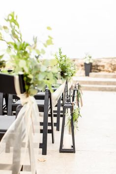 Outdoor wedding ceremony with rustic greenery decor