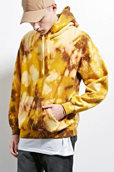 A fleece-knit hoodie by EPTM.™ featuring a bleach dye design, long dropped sleeves, a kangaroo pocket, and ribbed trim.
