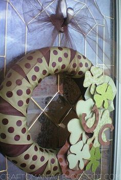 st patricks day wreath. Like the muted tones. I'm thinkin wooden shamrocks with scrapbook paper modpodged on.