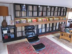 My dream record shelf! The combo of the directions of vinyls are what I want! I would want a rolling bar chair or a rolling library ladder. Record Shelf, Record Display, Record Cabinet, Record Rack, Cd Storage, Vinyl Storage, Vinyl Music, Vinyl Records, Minimalist Home