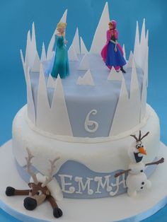 'Frozen' cake - two-tiered cake featuring flower paste 'ice' on the top tier and sugarpaster models of Sven and Olaf on the lower tier by Sunflower Cake Company. Frozen Theme Cake, Cupcake Cakes, Cupcakes, Sunflower Cakes, Novelty Cakes, Olaf, Themed Cakes, Amazing Cakes, Celebration