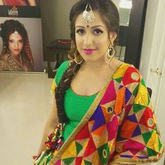 I think a phulkari suit would look cute for the engagement/sangeet!