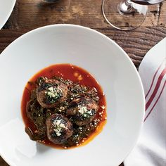 The secret to these luscious meatballs is using ground beef that has a fairly high fat content and mixing it with fresh ricotta, milk-soaked bread, and aromatic seasonings like fennel and lemon zest. Recipe: Beef-Ricotta Meatballs with Braised Beet Greens Meatball Recipes, Meat Recipes, Wine Recipes, Cooking Recipes, Yummy Recipes, Lamb Recipes, Meatloaf Recipes, Apple Recipes, Chicken Recipes