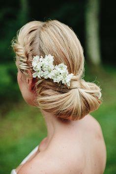 Beautiful twisted low bun with fresh flowers
