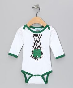 Get ready to rock St. Patrick's Day with this bodysuit that's more fun than finding a pot of gold at the end of a rainbow. With its shamrock tie graphic and simple snap bottom, those little Irish eyes will be smiling at the sight of this outfit.100% cottonMachine wash; tumble dryMade in the USA