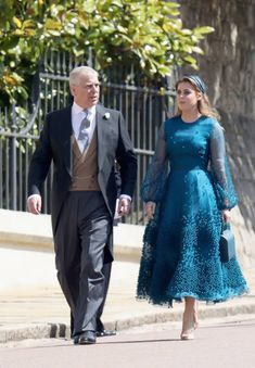 Britain's Prince Andrew, Duke of York, and his daughter Britain's Princess Beatrice of York arrive for the wedding ceremony of Britain's Prince Harry, Duke of Sussex and US actress Meghan Markle at St George's Chapel, Windsor Castle, in Windsor, on May 19, 2018.