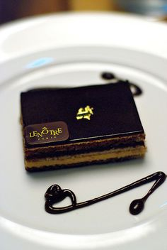 Lenôtre Opéra - Chocolate pastry with layers of almond biscuit, decadent chocolate ganache with coffee butter cream and topped with gold leaf by Sofitel Wentworth, Sydney.