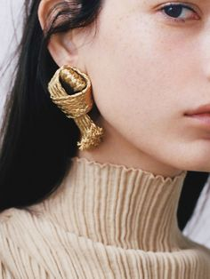 Louis Vuitton earrings; Jil Sander turtleneck.