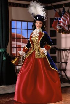 """Lovely Patriot Barbie® doll brings us back to revolutionary times in her elegant gown and navy military jacket. She wears a navy tricorner hat with a feather and carries a golden liberty bell. Discover her story and why she carries the bell in the accompanying storybook """"Liberty Dream"""" that tells a tale of Patriot Barbie® and how she made a difference in Philadelphia, 1776!"""