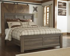 Ashley Juararo Bed Get the look of posh barn wood without setting foot in a salvage yard. Replicated rough-sawn oak of the Juararo queen panel headboard has a vintage finish that is reminiscent of a t