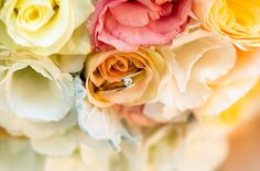marco photo of the engagement ring positioned in the bouquet