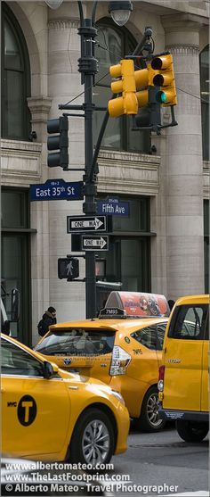 NYC Cabs in the Fifth Avenue, Manhattan, New York.   By Alberto Mateo, Travel Photographer.