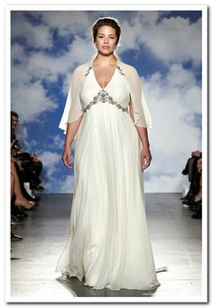 This plus size empire waist wedding dress is on the fashion runway featuring a light & flowing shawl cover up. Plus size wedding dresses like this one can be easily created by our USA dress design firm. We specialize in affordable custom plus size wedding dresses (as well as replicas of couture gowns).  Email us a picture for pricing.  Get more info at www.dariuscordell.com