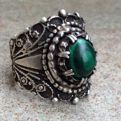 1970's Sterling silver malachite scroll ring 7.25 Absolutely gorgeous HANDMADE sterling silver ring with malachite stone. This ring is beautifully made with intricate scroll work and rope edge details. I purchased this ring from a woman whose friend had made this for her in the 1970's. The craftsmanship is amazing!!! The ring weighs 14 grams and is a size 7.25. There are no markings, but it tested positive for Sterling. Don't miss out on this one of a kind beauty! Vintage Jewelry Rings