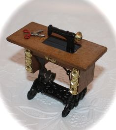 Vintage Doll House Miniature Furniture Victorian Sewing Machine w/Scissors - Peddle & Table. $8.99, via Etsy.