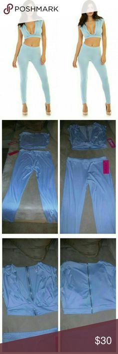 Sexy Powder Blue Crop Top Stretch Pant Set Size large, brand new with tags attached! Stretchy two piece sleeveless pant set with bodycon fit, light powder blue color. Top features silver tone full zip back and deep cleavage front. No closures on bottoms, which fit like leggings (elastic waist). Nice fit for spring! Pants Leggings