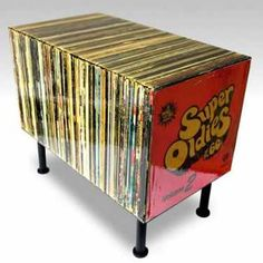 Old vinyl records created a funky coffee table!! I need to do this for Mario with his blues records!