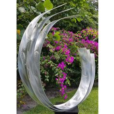 Title: Triple C 24 Dimensions: 54 x 18 x 9. The height includes the 24 tall base. Color: Silver This unique eye-catching, breath-taking free-standing sculpture is a spectacular architectural feature to add distinctive modern style to your landscape, and a stunning focal point for