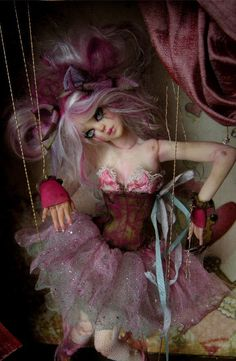 Broken puppet art doll by Nicole West. Wonderful use of the frame/box concept.